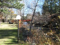 View of yard and creek. Think it is Fall River.