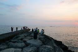 The breakwater is a popular spot to watch the sunset