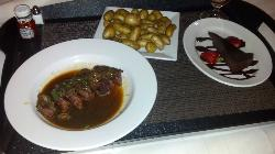 Room Service - with large potatoe portion, steak medallions that were rare, and tasted terrible.