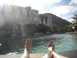The pool, hotel and our feet (for a sense of size perspective)