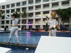 Balinese dancers by the pool