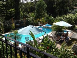the pool area viewed from the dining balcony