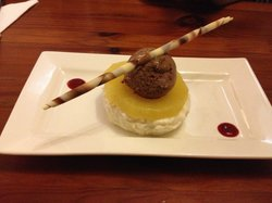 Dessert: Chilled coconut and Malibu rice pudding, poached pineapple, chocolate and mascapone gel