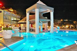 Main Pool at night, Pavilion Rest. & stage in background