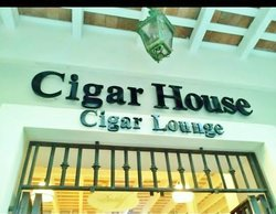 ‪The Cigar House‬