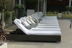 Sunloungers in centre hotel pool