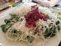 watercress and cabbage topped with crispy prosciutto
