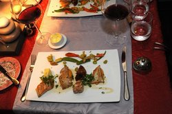 Assortiment of four different grilled fishes and vegetables
