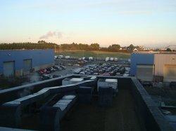 View of car garage/dealership next door