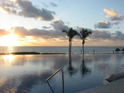 Peaceful time by the pool at sunrise..