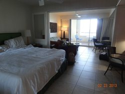 Inside the room with king size bed and fully equipped kitchen.