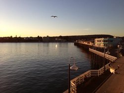 beautiful sunset from the left lights up the pier as I enjoy it all from the balcony of the Stag