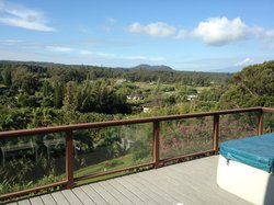 Large deck with hot tub, beautiful views of mountain and sea.