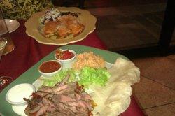 Our dinner entries,including steak fajitas.