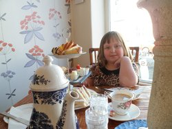 A very happy granddaughter with her afternoon tea.