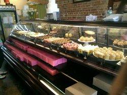 one half of cupcake display case...... Yummmmmmmm!