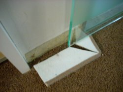 Bad maintenance, a piece of wood holding the  bathroom door.