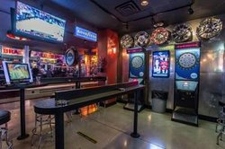 Game room with 2 dart boards and 2 Ms. Pacman/Galaga games