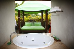One of the rooms has Jacuzzi Tub looking outside onto your private sun bed