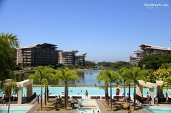 pool area fronting the lagoon and condo buildings