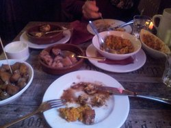 Delicious tapas -fried potatoes, stuffed mushrooms, sherry chicken, paella, homemade pesto with