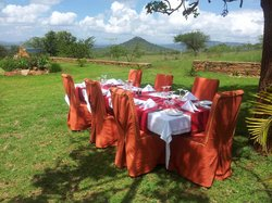 Lunch setting outdoors with a view to the Kilima Kiu mount