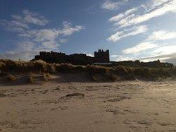 bamburgh castle from beach