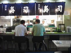 Busy Sushi Chefs behind counter