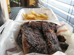 half slab of ribs with fries