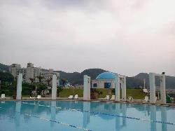 Colorful pool with white and blue chapel cafe forms exotic air