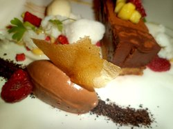 Chocolate, coconut snow, pineapple coulis