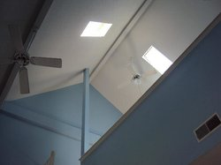Skylights above our bed and only a half wall.  No privacy or darkness to sleep in.