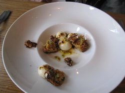 Licorice pannacotta with walnut and passion fruit