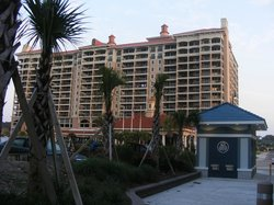 View of hotel from across the road from the resort