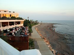 Evening view of the dining terraces from the larger pool area