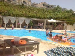 View from a sun bed of the pool bar!