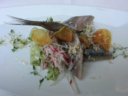 Herring on top of cucumber radish salad