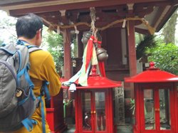 Shozo, teaching us how to pray at the temple (perhaps to make us walk faster!)