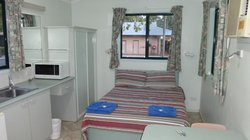 Double bed and kitchen