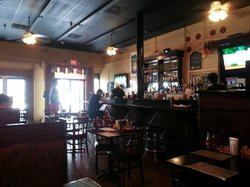 Looking towards the front door of Daisy Dukes from a booth.