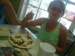 Emma eating her first Beignet