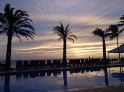 sunset over one of the pools