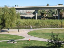 view of walking paths and highway from room