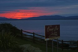 Sunset over Creevy Pier Hotel