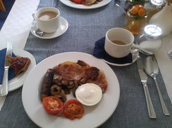 Beautiful grilled breakfast, meaty sausages and lovely thick bacon.