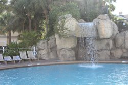 water fall at the pool. The hot tub is on top of it.