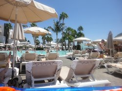 Sun beds at quiet pool