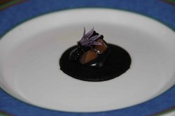 A delight to the eye and an explosion of flavour, including a fresh edible flower on a squid ink