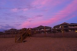 View  of our room from the beach at sunrise