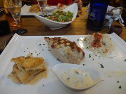chicken stuffed with feta and peppers, side of potato and rice with tzatziki